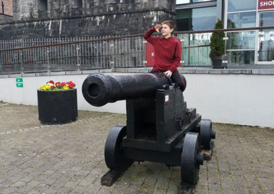 Country Tour boy sitting on canon